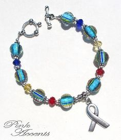 Autism Awareness: Blue/Red/Yellow Lampwork Glass and Sterling Silver Plated Bracelet, 7.50 inches.  30% of your purchase price goes directly to the Organization for Autism Research!  OAR is the only autism organization which focuses solely on applied research, funding studies that investigate treatments, educational approaches, and statistical aspects of autism.