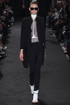 Ann Demeulemeester #ss16 #pfw Venus in Heels  Sheer lurex bodies, tie up waistcoats, bullet-lined leather gilets in white and black, and dagger-sharp heel-cum-boots brought the sadomasochism vibe to fore. Each look was teamed with a body-harness or a square breast plate, all of which culminated in a neck elongating choker. This sexual power was palpable, and models apathetically stomped through the giant space with a look of total control. Provided all were consenting, this was anyone's…