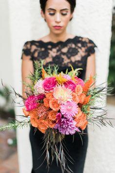 Bright bridal bouquet and a black wedding dress | Dana Fernandez Photography | see more on: http://burnettsboards.com/2014/10/dia-de-los-muertos-wedding-inspiration-shoot/