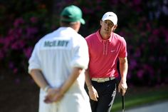 April 13: Rory McIlroy and caddie J.P. Fitzgerald pondered a putt on the 13th green.