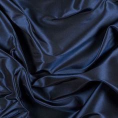 Made just for Mood, introducing a Navy Silk Taffeta of the highest quality. Lightweight, with taffeta's trademark crispness and rustle, this material produces a soft sheen. Silk taffeta is perfect for special occasion wear.