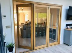 Finesse Internal Bifold Door connects lounge and dining room Furniture Design Modern, Oak Interior Doors, Bifold Doors, Living Room Door, Interior, New Homes, Folding Room Dividers, Room Divider Doors, Room
