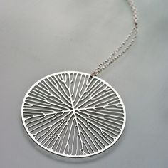 The pattern was grown in a computer simulation of leaf venation and etched from a sheet of stainless steel.