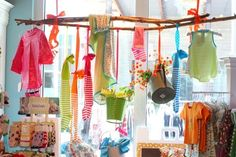 Cute store display ... great use of space, eye catching, love the colors and textiles