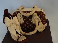 I made this shoe to match a Louis Vuitton purse cake. The high heel shoe is made out of fondant. I used gold dragee for the details. The shoe template I used is the same that I put here on CC. You can see the shoe template on my photo gallery. I just had the top part and the bow.