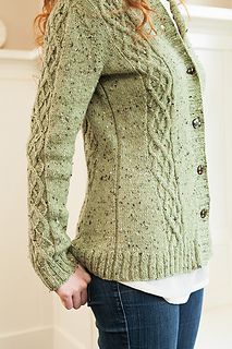 """A simple twist on a classic look, this cardigan uses cables and twisted stitches to create a """"faux argyle"""" motif. With just enough adornment to make it interesting and fun to knit, the Cabled Faux Argyle Cardigan shows off a flattering and timeless silhouette while highlighting the beauty of City Tweed. The cardi is easy to customize - simply adjust the waist shaping as needed in the stockinette portion or modify the overall length for a perfect fit."""