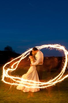 Sparklers at nightfall - Kingscote Barn, Somerset wedding venue by Charlotte Bellamy Photography