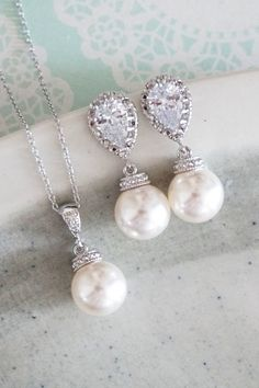 Silver tone ( rhodium plated) Teardrop Cubic Zirconia ear posts. 925 sterling silver posts. Swarovski Pearl drops (10mm). High quality rhodium