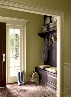 LOVE this earthy entryway. Wall paint color: Wasabi; Trim paint color: Hush; Accent wall paint color: Vintage Wine. All by Benjamin Moore