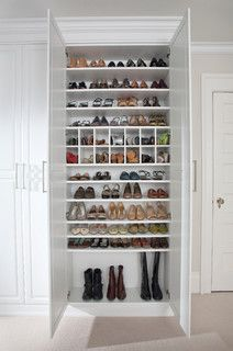 An In The Wall Closet With Slot Sliding Full Length Set Of Shelves That