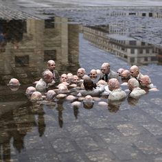 Street art sculpture by Issac Cordal in Berlin . Called Politicians discussing global warming