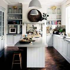 This is my kitchen! Simple palate, room for books and items for quick access. Not a lot of overhead cabinets. Pantry w/ glass. Lots of light and simple decorations. Love the fireplace look to stove.