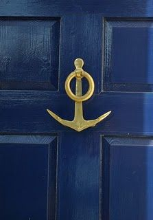 blue door & brass anchor knocker!