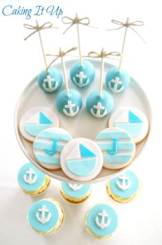 Nautical cookies, cupcakes and cake pops www.facebook.com/cakingitup