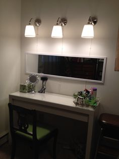 Ikea vanity; Malm dressing table and arstid wall lamps.