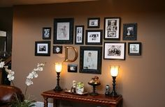 This kind of display can be easily updated with many new photos of your loved ones. Get black and white photos of you and your family and put them in frames in the same color. Start hanging the pictures on your wall, the don;t need to be perfectly ordered, that's the point.