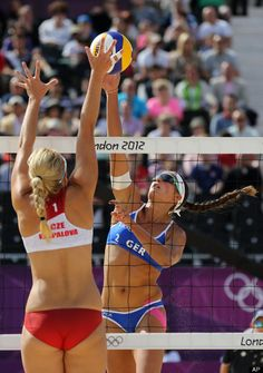 Hana Klapalova, left, from Czech Republic tries to block Illka Semmler, right, from Germany during their Beach Volleyball match at the 2012 Summer Olympics, Saturday, July 28, 2012, in London