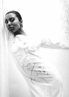 model donyale luna wearing a white crepe rudi gernreich dress which was then painted on by salvador dalí. photographed by william claxton, circa 1966.