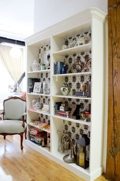 Tutorial to add beveled crown molding on Billy bookcase (Ikea) -- This is an excellent storage solution for A's bedroom. Besides the crown molding, the custom back panel allows you to pull in other colors or patterns