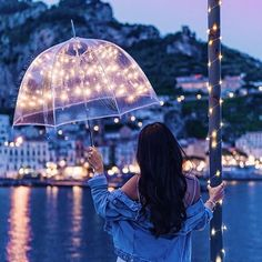 Romantic night at the amalfi coast with the magic umbrella. Fairy Light Photography, Girl Photography Poses, Fille Gangsta, Nature Landscape, Cute Girl Wallpaper, Jolie Photo, Creative Portraits, Girl Photos, Wallpaper Backgrounds