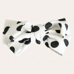Striking black polka dots lend a playful touch to a white bow tie clip that's perfect for adding pizzazz to your up do and topping off your tresses in girlish glam, signature style.