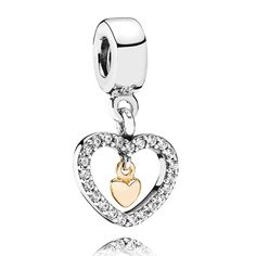 PANDORA Forever in My Heart dangle charm in sterling silver and 14K yellow gold. A frame of sparkling clear cubic zirconia surround a golden heart in this elegant two-tone charm.<br><strong>Style: </strong>791421
