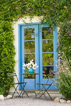 residential, patio, blue french doors, garden, metal table, chairs