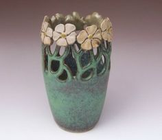 Art Nouveau pottery   http://www.maidofclay.com/art-nouveau-style.html