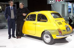 Sergio Marchionne, chairman and chief executive officer of Fiat SpA and Chrysler Group LLC, right, poses for a photograph with John Elkann, chairman of Fiat, with a 1970 Fiat 500L while touring the Chrysler Group display at the North American International Auto Show (NAIAS) in Detroit, Michigan, U.S., on Tuesday, Jan. 11, 2011. The 2011 Detroit auto show runs through Jan. 23 and will feature 30-40 new vehicle premieres. Photographer: Andrew Harrer/Bloomberg via Getty Images