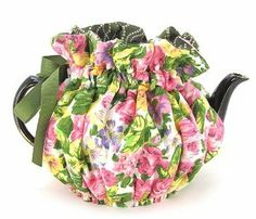 Tea Cozy Fully Lined in Contrast Fabric Made in the USA Fabulous Quality 8 Cup Size (Painted Rose) by Thistledown. $34.95. Color coordinated linings and ribbons with sealed ends to prevent fraying. Need we say more.. Machine wash and dry. Guaranteed to last through years of laundering.. Thick polyester batting offers superior heat retention. This is the best cozie we have ever carried, fabulous fabrics with a true design eye.. Matched it with terrific quality and you have a cozi...
