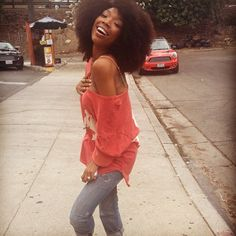 Brandy Norwood with a natural hair afro