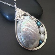 shell pendant by lidiya534 - this links to a gallery of her wire wrap pendants