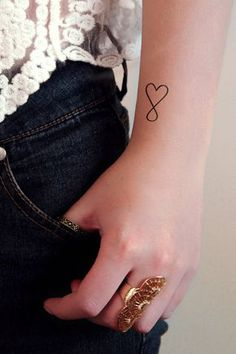 A set of four temporary infinite love tattoos. Perfect for Valentines Day!