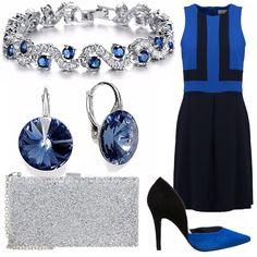 Outfit elegante per cerimonia che si basa sui colori del blu, del nero e dell'argento. Il vestito blu elettrico e nero con motivi geometrici, le scarpe sono delle décolleté dello stesso colore, la pochette riprende un po' l'argento dei gioielli.