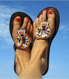 As seen in Stella! Get that African feel - stylish and colourful chocolate leather flip flop with an elegant beaded multi coloured disc with a whole in the middle. Incredibly soft leather with a snug fit around the foot. For each pair of sandals sold we will donate 5.00 to the Brydges Centre and little Orphange in Nairobi.    This product is handmade in Africa    Thong Style Sandal    Genuine Dark Leather Upper %2...
