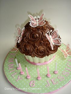 Giant rich chocolate cupcake by Darcy's Cupcake Creations, via Flickr