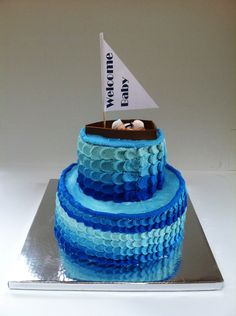 Nautical baby shower cake - Buttercream icing.  First time using the petal technique.  Not perfect but I learned a lot :).  Baby and boat are gum paste