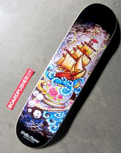 """Storm In a Teacup"" is today's Featured Deck designed by Erika Pearce. This board is the 7.25 mini, but you can see all of Erika's traditional tattoo and Mexican themed skateboard graphics on various shapes at www.BoardPusher.com/shop/ErikaPearce."