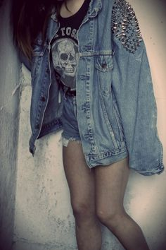 studded denim jacket and ripped jeans with skull tee
