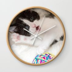 """Good times! Rethink the traditional timepiece as functional wall decor. You'll love how our Artists are converting some of their coolest designs specifically into Wall Clocks. Constructed with premium, shatter-resistant materials, with three frame color options.      - Natural wood, black or white frame options   - Dimensions: 10"""" diameter, 1.75"""" depth   - Choose black or white hands to match frame or design   - High-impact plexiglass crystal face   - Backside hook for easy hanging"""