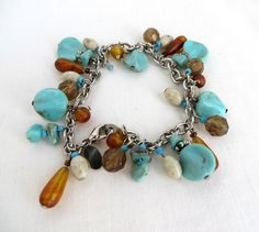 Wonderful Gift Idea! Vintage Genuine Turquoise, Amber Glass, Plastic and Stone Beads on a Silver tone Chain Link Bracelet, with a Lobster Claw  Clasp.  * The bracelet measures 7 inches * Signed...