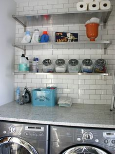 dark grout, white subway tiles, Organized laundry