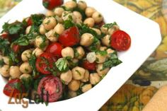 Tomato and Chickpea Salad - Simple and flavorful springtime salad with a lovely vinaigrette from www.zagleft.com