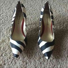 I just discovered this while shopping on Poshmark: Zebra/Red Pointed Toe Heels. Check it out!  Size: 8