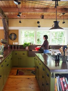 Erin and Adam McIntyre Real-Life Makeover: Modern Barn Home  I love all the industrial lighting in this kitchen, it somehow gives it an older feel.