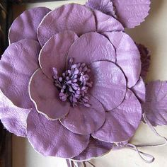 """Tres Chic leather rose, perfect for hats and headbands. Hand cut, shaped and assembled with leaves, stamens and vines all in a lovely Orchid shade. Overall it measure 7 1/2"""" , 2 leaves and vines."""