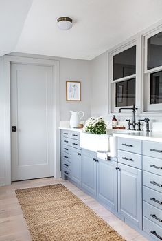 Mudroom After - Bobby Berk Gave His Parents' Home A 'Queer Eye' Makeover With Target - Lonny Black Slate Floor, White Oak Floors, Wood Cladding, Slate Flooring, White Tiles, Kitchen Cabinetry, White Cabinets, Mudroom, Interior Design