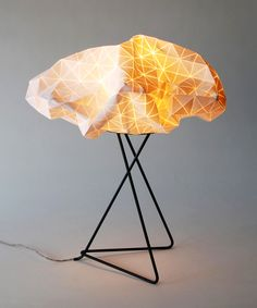 Remember the Geo Cushion? Here is a beautiful table lamp created by the same designer, Mika Barr. The lampshade is made from textured textile that makes origami-like creases. Origami Table, Origami Lamp, Home Lighting, Lighting Design, Lamp Design, Black Table Lamps, Contemporary Table Lamps, Dot And Bo, Light Art