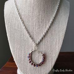 Silvertone spiral purple iridescent glass bead necklace
