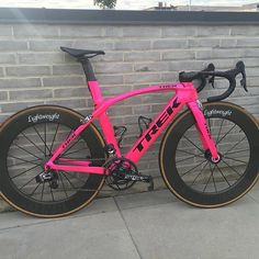 Crazy Hot Pink Trek Madone with SRAM ETap on Lightweight wheels. TAG A FRIEND…